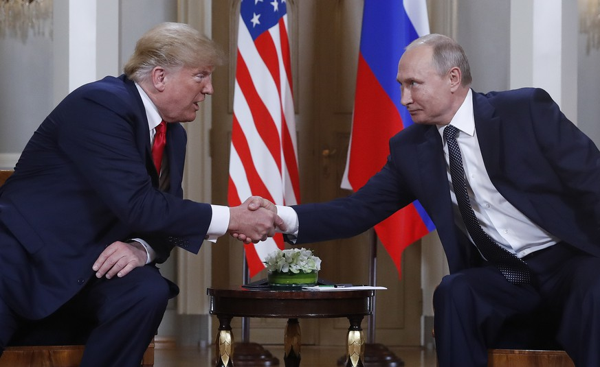 U.S. President Donald Trump, left, and Russian President Vladimir Putin, right, shake hand at the beginning of a meeting at the Presidential Palace in Helsinki, Finland, Monday, July 16, 2018. (AP Photo/Pablo Martinez Monsivais) |