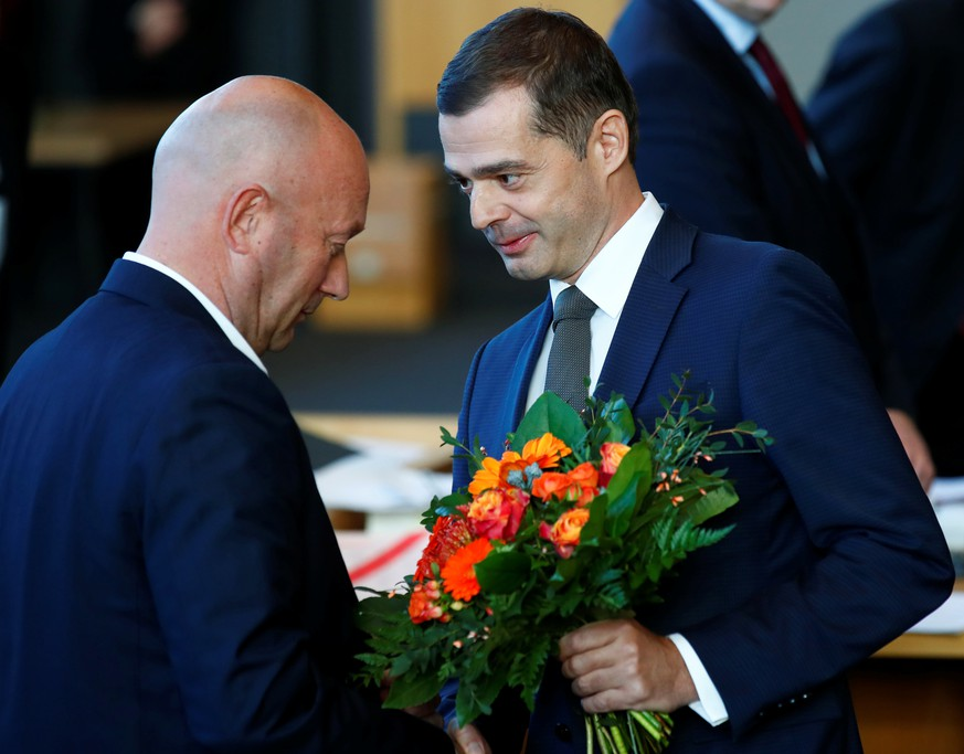 Mike Mohring of the Christian Democratic Union (CDU) congratulates FDP candidate Thomas Kemmerich after he was elected new Thuringia premier at the  state parliament in Thuringia in Erfurt, Germany, February 5, 2020. REUTERS/Hannibal Hanschke