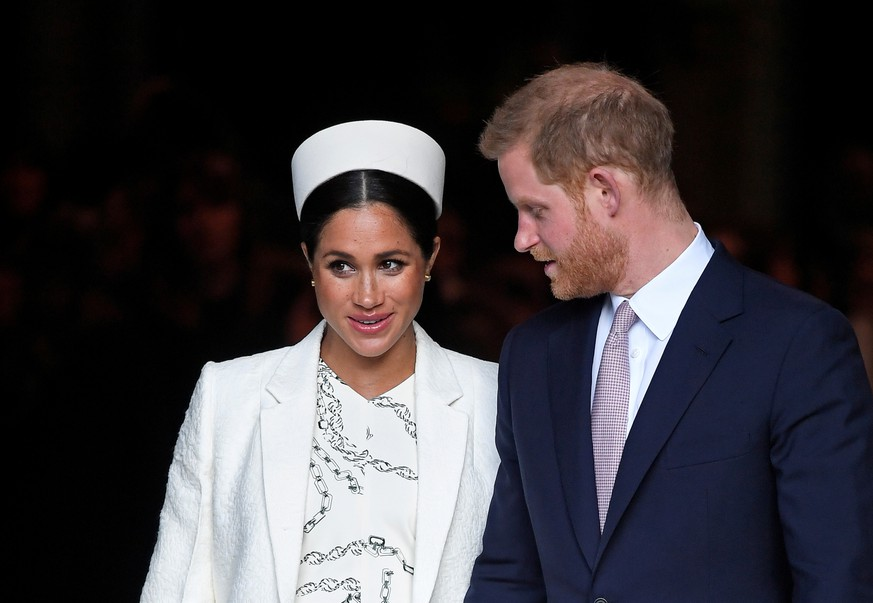 FILE PHOTO: Britain's Prince Harry and Meghan, Duchess of Sussex leave after the Commonwealth Service at Westminster Abbey, on Commonwealth Day, in London, Britain March 11, 2019.  REUTERS/Toby Melville/File Photo