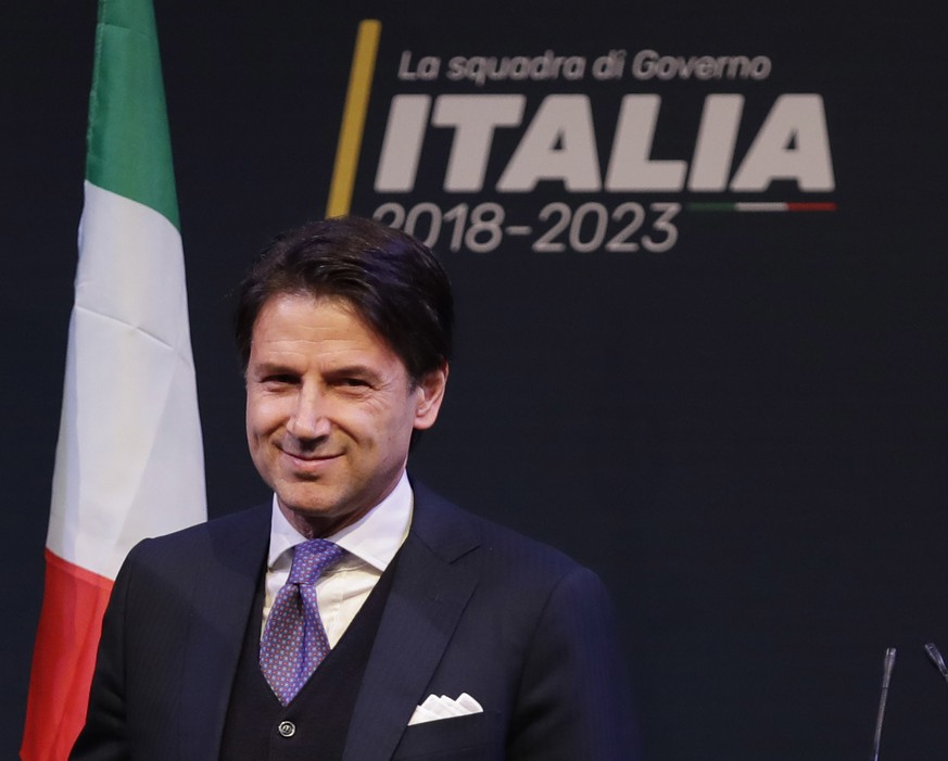 In this photo taken on Thursday, March 1, 2018, Giuseppe Conte smiles during a meeting in Rome. Italy edged toward its first populist government Monday as the eurosceptic 5-Star Movement and the right-wing League indicated a 54-year-old law professor with no political experience as their candidate for premier. Neither 5-Star leader Luigi Di Maio nor League leader Matteo Salvini named Giuseppe Conte in brief remarks to reporters after leaving a closed-door meeting with President Sergio Mattarella in what could be final consultations before forming a government 11 weeks after elections left Italy with a hung parliament. But, in a breach of protocol, Di Maio identified Conte to reporters outside the Quirinale presidential palace and posted his name on the movement's popular block. (AP Photo/Alessandra Tarantino)