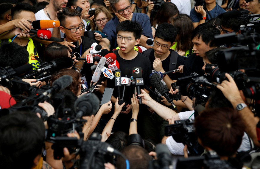 FILE PHOTO: Pro-democracy activist Joshua Wong talks to the media outside the Legislative Council during a demonstration demanding Hong Kong's leaders to step down and withdraw the extradition bill, in Hong Kong, China, June 17, 2019. REUTERS/Thomas Peter/File Photo