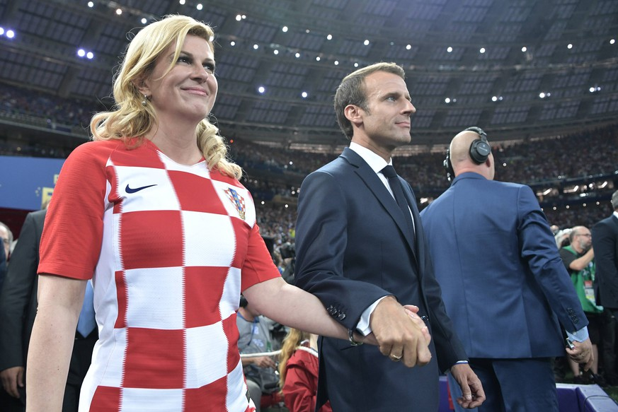 MOSCOW, RUSSIA - JULY 15, 2018: Croatia s President Kolinda Grabar-Kitarovic (L), and France s President Emmanuel Macron (C) at the official award ceremony after the final match of FIFA World Cup WM Weltmeisterschaft Fussball Russia 2018 between France and Croatia at Luzhniki Stadium; France won 4-2. Alexei Nikolsky/Russian Presidential Press and Information Office/TASS PUBLICATIONxINxGERxAUTxONLY TS089BA0