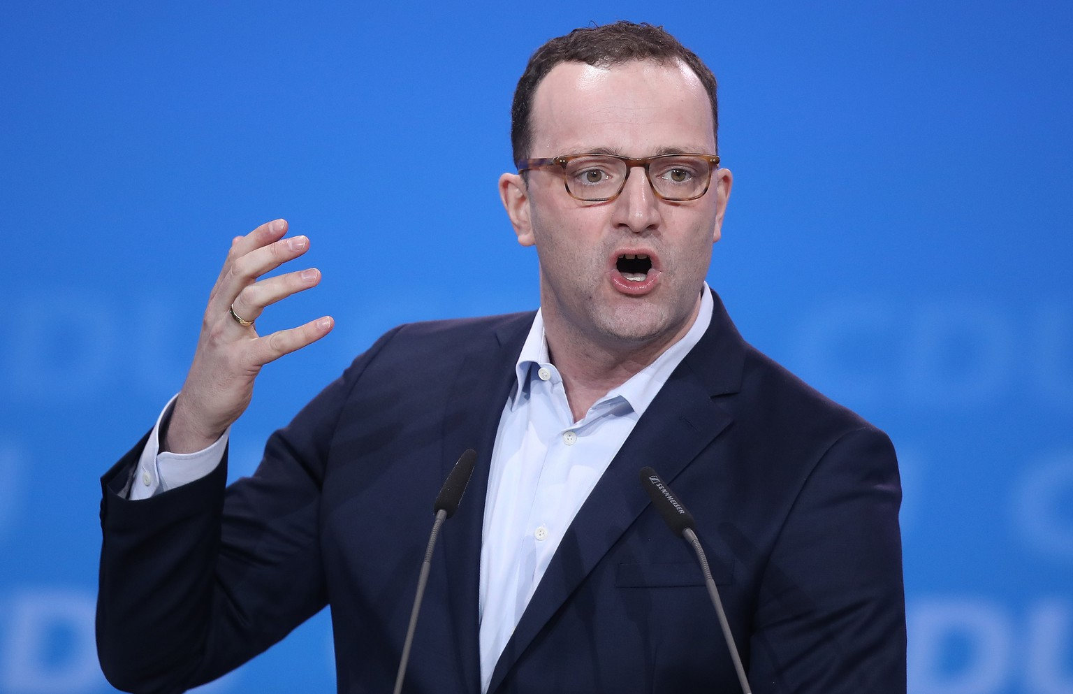 BERLIN, GERMANY - FEBRUARY 26:  Jens Spahn, who has been an outspoken critic of Chancellor and CDU Chairwoman Angela Merkel and who is slated to become the next German health minister, speaks under a slogan that raeds: