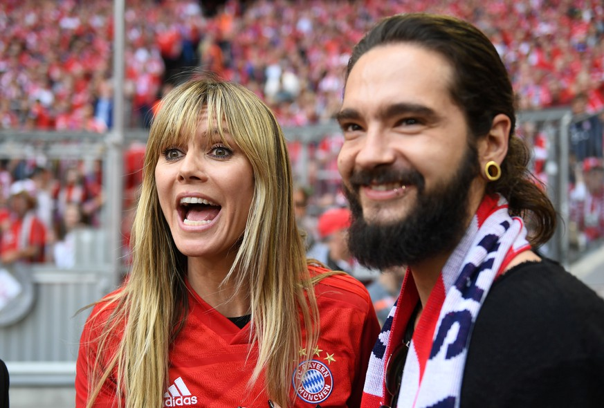 Soccer Football - Bundesliga - Bayern Munich v Eintracht Frankfurt - Allianz Arena, Munich, Germany - May 18, 2019  Heidi Klum and Tom Kaulitz before the match   REUTERS/Andreas Gebert  DFL regulations prohibit any use of photographs as image sequences and/or quasi-video