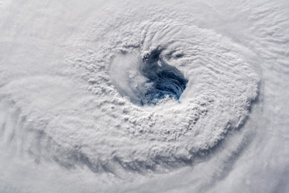 In this Sept. 12, 2018 photo provided by NASA, Hurricane Florence churns over the Atlantic Ocean heading for the U.S. east coast as seen from the International Space Station. Astronaut Alexander Gerst, who shot the photo, tweeted: