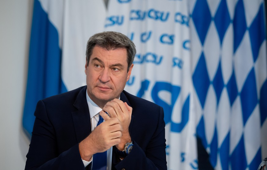 Bavarian State Prime Minister and Christian Social Union (CSU) party leader Markus Soeder sits in his office as he attends a virtual CSU party convention in Munich, Germany, September 26, 2020.     Sven Hoppe/Pool via REUTERS