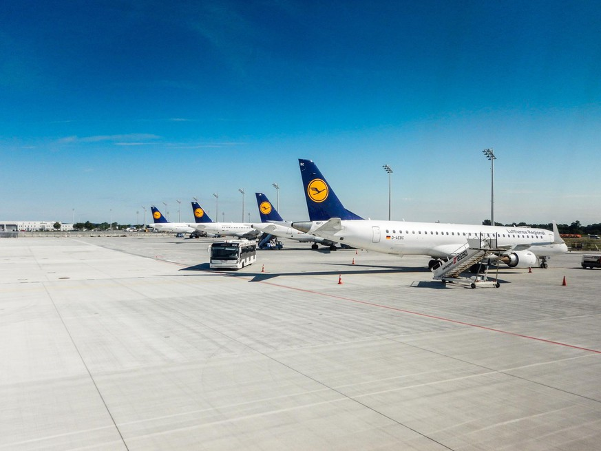 Munich, Germany - August 17, 2014: A series of Lufthansa airbus A321-300 airplane parked on the track of Munich international hub airport before take off. Munich is a Lufthansa hub and Lufthansa is one of the biggest airline company in all the world. Image taken from an airplane porthole.