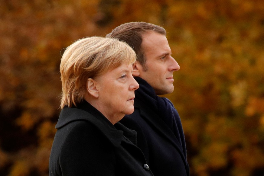 French President Emmanuel Macron and German Chancellor Angela Merkel stand together in the Clairiere of Rethondes during a commemoration ceremony for Armistice Day, 100 years after the end of the First World War, in Compiegne, France, November 10, 2018. REUTERS/Philippe Wojazer/Pool