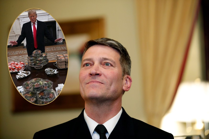 In this April 16, 2018, photo, U.S. Navy Rear Adm. Ronny Jackson, M.D., sits with Sen. Johnny Isakson, R-Ga., chairman of the Veteran's Affairs Committee, before their meeting on Capitol Hilin Washington. Jackson is President Donald Trump's nominee to be the next Secretary of Veterans Affairs. Now it's Washington's turn to examine Jackson. The doctor to Presidents George W. Bush, Barack Obama and now Donald Trump is an Iraq War veteran nominated to head the Department of Veterans Affairs. (AP Photo/Alex Brandon) |